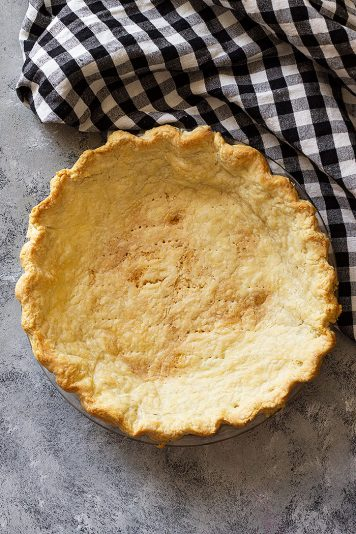Top down view of a golden blind baked pie crust.