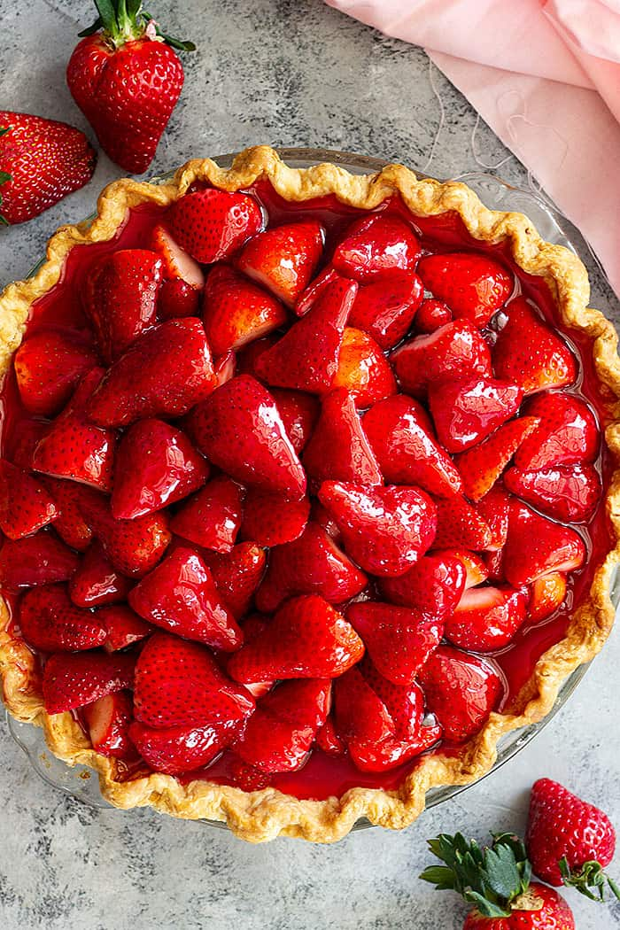 Top down view of a fresh strawberry pie.