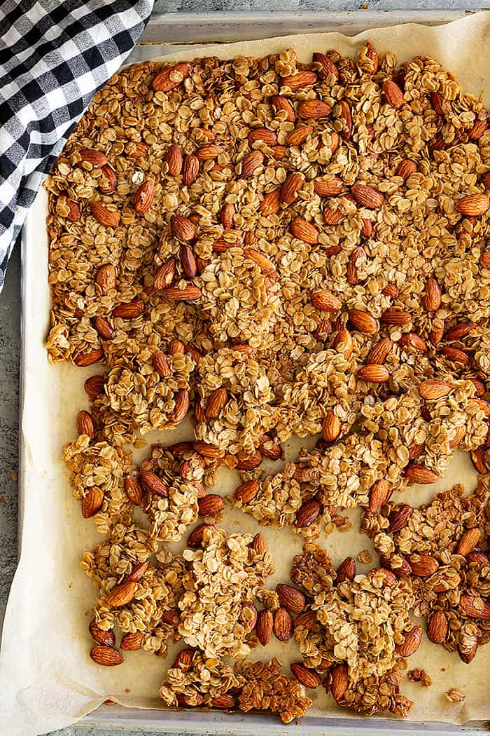 Top down view of granola on a baking sheet.