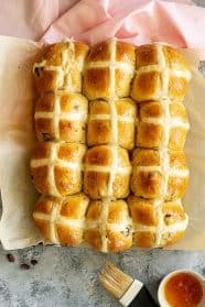 Top down view of a pan of freshly baked hot cross buns.
