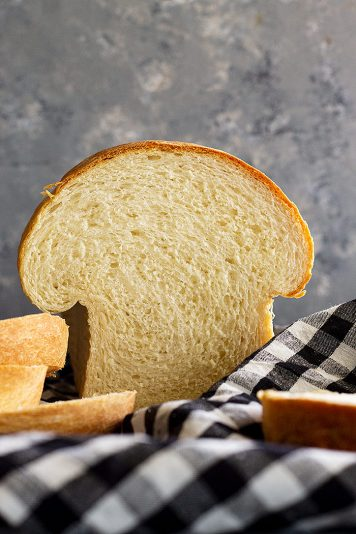 Loaf of bread that has been sliced into.