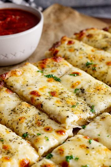 Close up of cheese breadsticks.