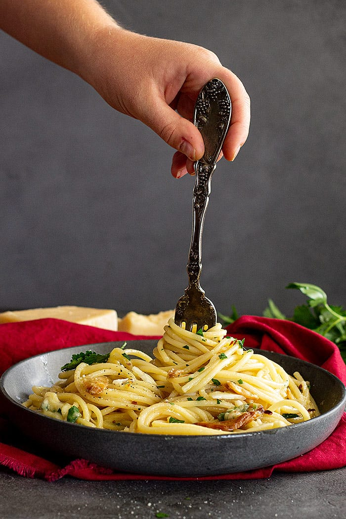 Twirling pasta onto a fork.