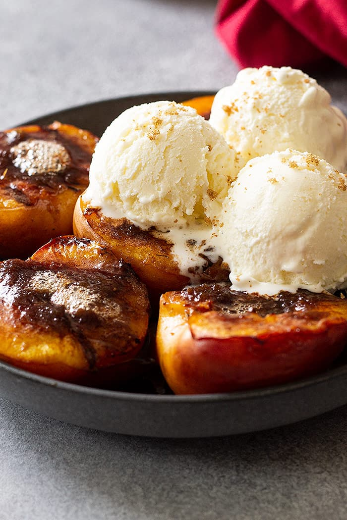 Grilled peaches with vanilla ice cream.