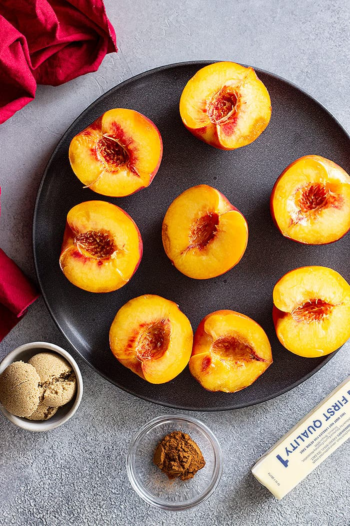 Top down of peaches sliced in half ready for grilling.