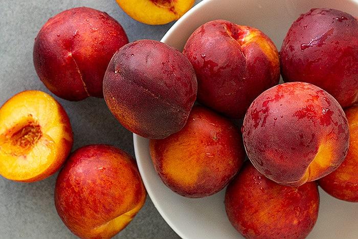 A bunch of fresh peaches.