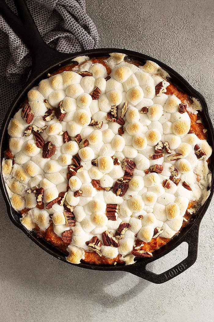 Overhead view of casserole fresh from the oven. Marshmallows are puffy and golden.