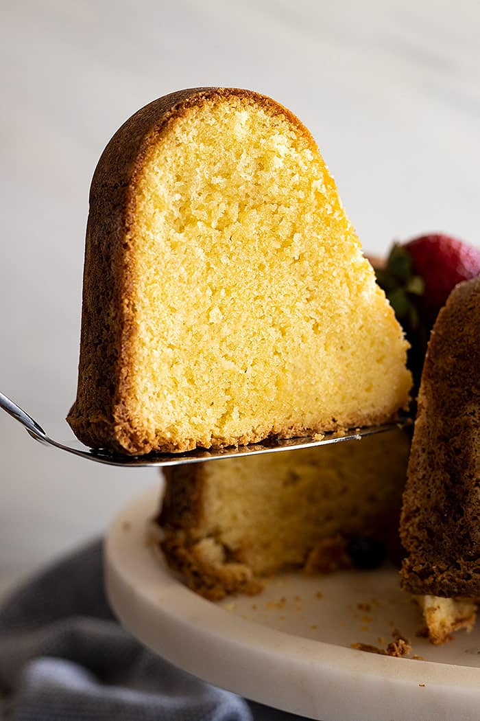 A slice of cake being cut from the cake.