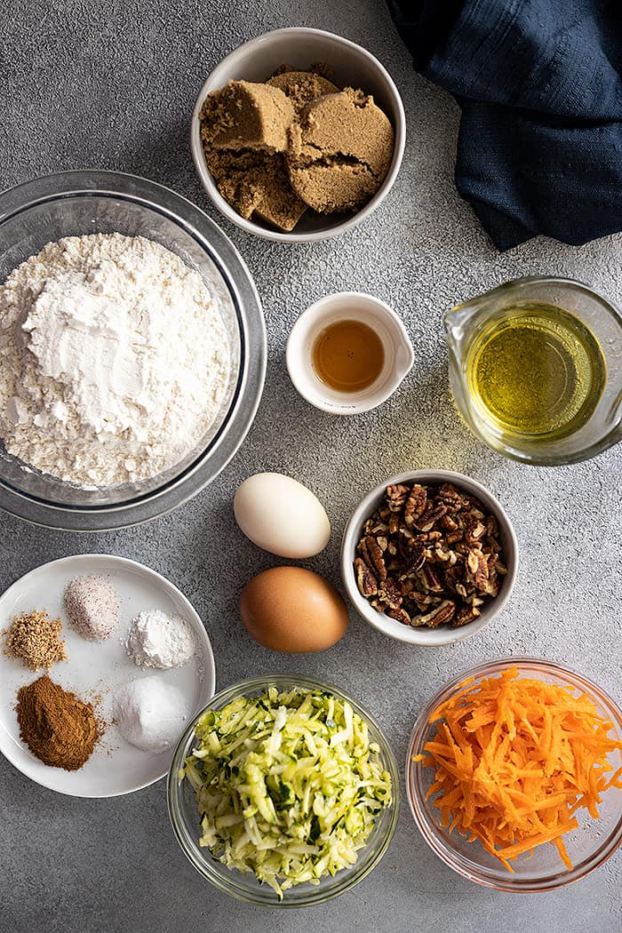 Overhead view of all the ingredients needed to make zucchini carrot bread.
